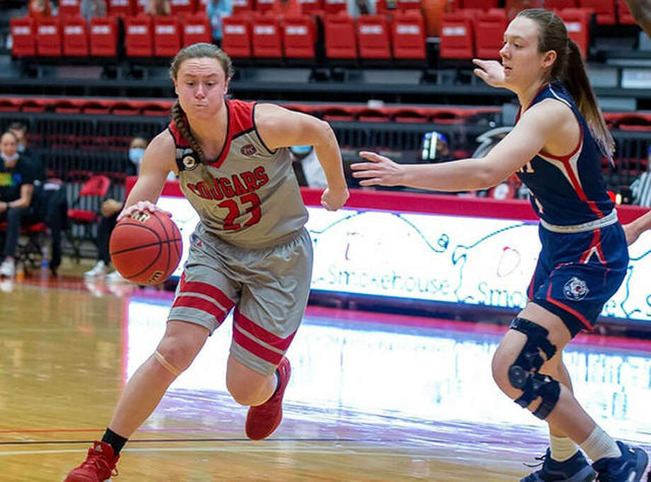 SIUE's Allie Troeckler (left) drives on a Belmont defender in Saturday's OVC game at First Community Arena in Edwardsville. Photo: Scott Kane / SIUE Athletics