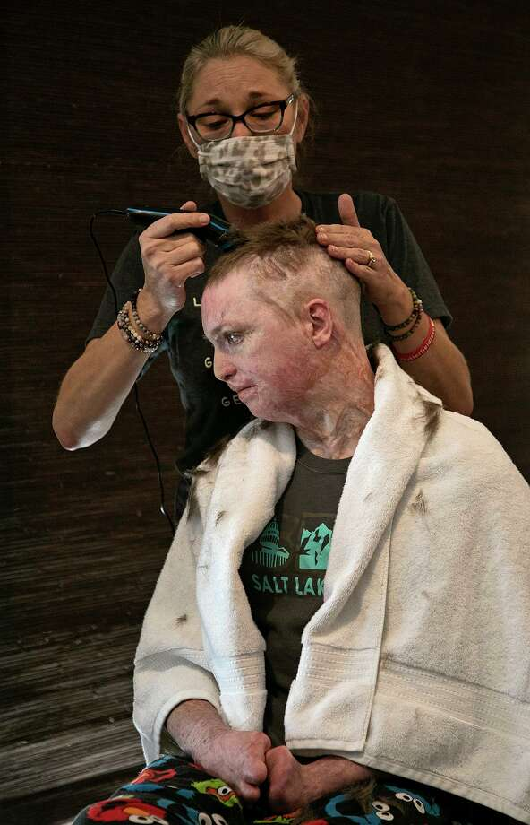 """Deona Jo """"DJ"""" Sutterfield trims her son Zachary's hair at their San Angelo home on Monday, Feb. 1, 2021. DJ Sutterfield has been named the 2021 Texas Mother of the Year by the national nonprofit American Mothers, Inc. Photo: Lisa Krantz /Staff Photographer / San Antonio Express-News"""
