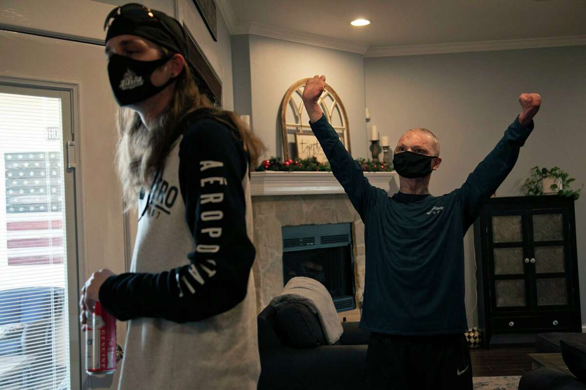 Brothers Danny and Zachary Sutterfield gather for dinner at their parents' San Angelo home on Monday, Feb. 1, 2021. Zachary, now 22, is continuing to recover after he was critically injured in a fire that someone deliberately set at a San Marcos apartment building in July 2018. The crime remains unsolved.