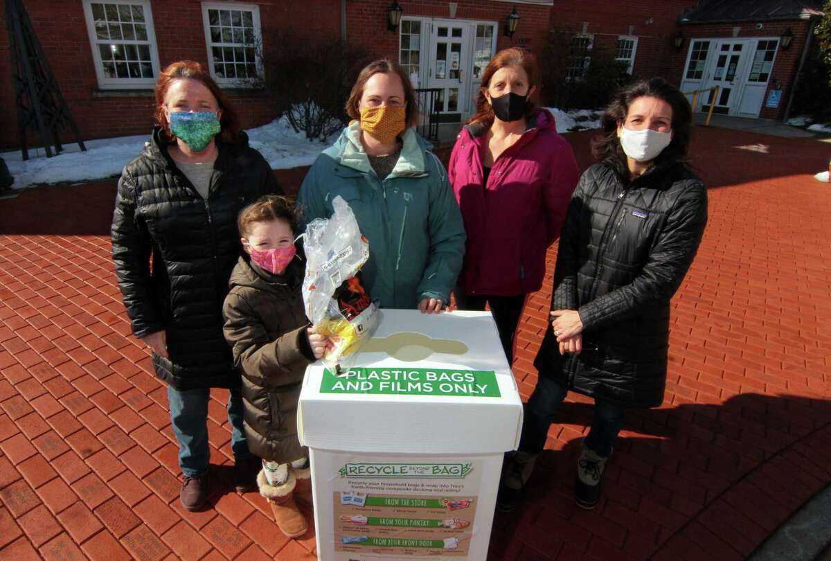 Members of Sustainable Trumbull pose with one of the group's recycling bins at Trumbull Town Hall in Trumbull, Conn., on Saturday Feb. 6, 2020. From left to right is Mary Isaac, Autumn Lang, 6, April Lang, Pam Roman and Mari Kackson. April is coordinating a recycling challenge to get plastic bags out of landfills and prevent them from becoming litter.