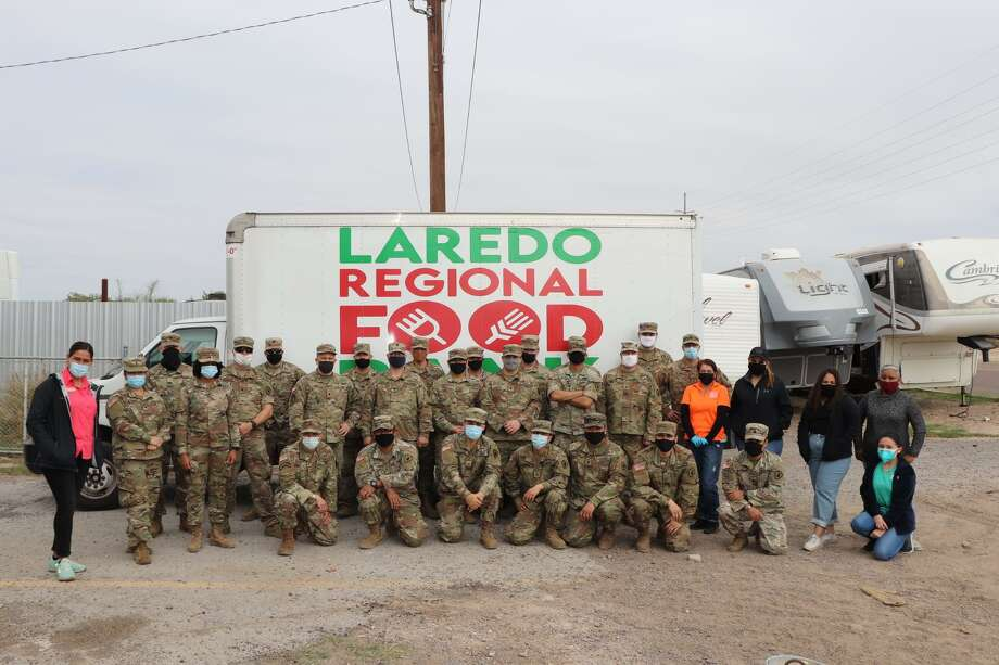 The Laredo Regional Food Bank partnered with the Texas National guard and the offices of Webb County Commissioner Cindy Liendo to distribute hundreds of meals Friday to Laredoans in need. Photo: Courtesy / Offices Of Webb County Commissioner Cindy Liendo