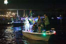 Mardis Gras themed boats paraded past excited onlookers crowded along the Kemah Boardwalk during the Yachty Gras Boat Parade Saturday, Feb. 6.