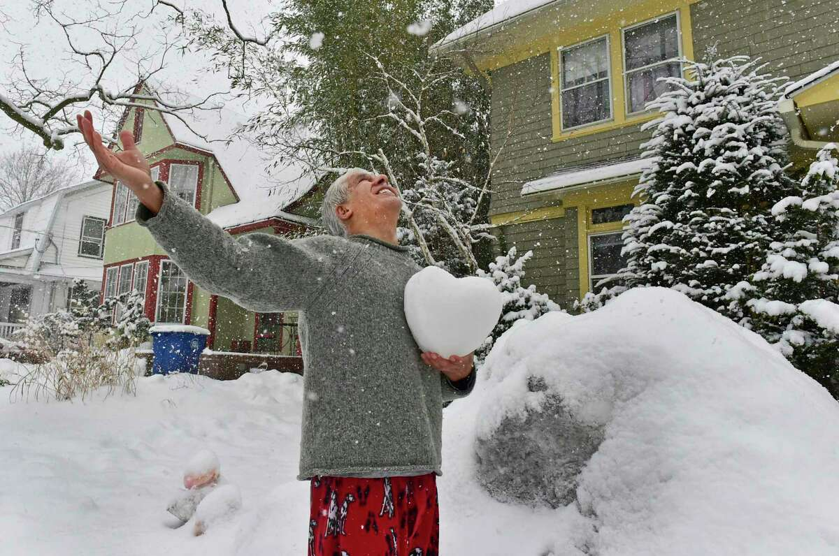 New Haven, Connecticut - Sunday, February 07, 2021: David Sepulveda of New Haven, an experienced snow sculptor, throws his arm open to the snowfall Sunday afternoon. He found the meme intriguing and said the thought of making it into a sculpture