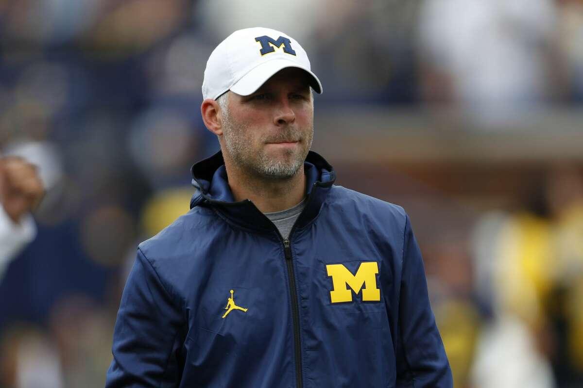 Ben McDaniels, Michigan quarterbacks coach, watches before an NCAA college football game against Rutgers in Ann Arbor, Mich., Saturday, Sept. 28, 2019. (AP Photo/Paul Sancya)