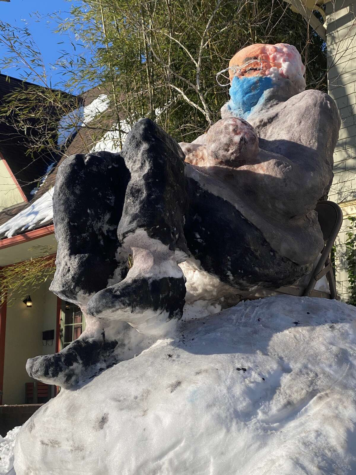 The sun beats down on SnowBernie's face. He's made snow sculptures before, and said