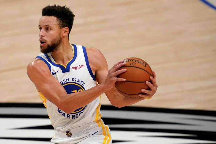 Golden State Warriors' Stephen Curry advances the ball up court in an NBA basketball game against the Dallas Mavericks in Dallas, Saturday, Feb. 6, 2021. (AP Photo/Tony Gutierrez) Photo: Tony Gutierrez, STF / Associated Press / Copyright 2021 The Associated Press. All rights reserved.