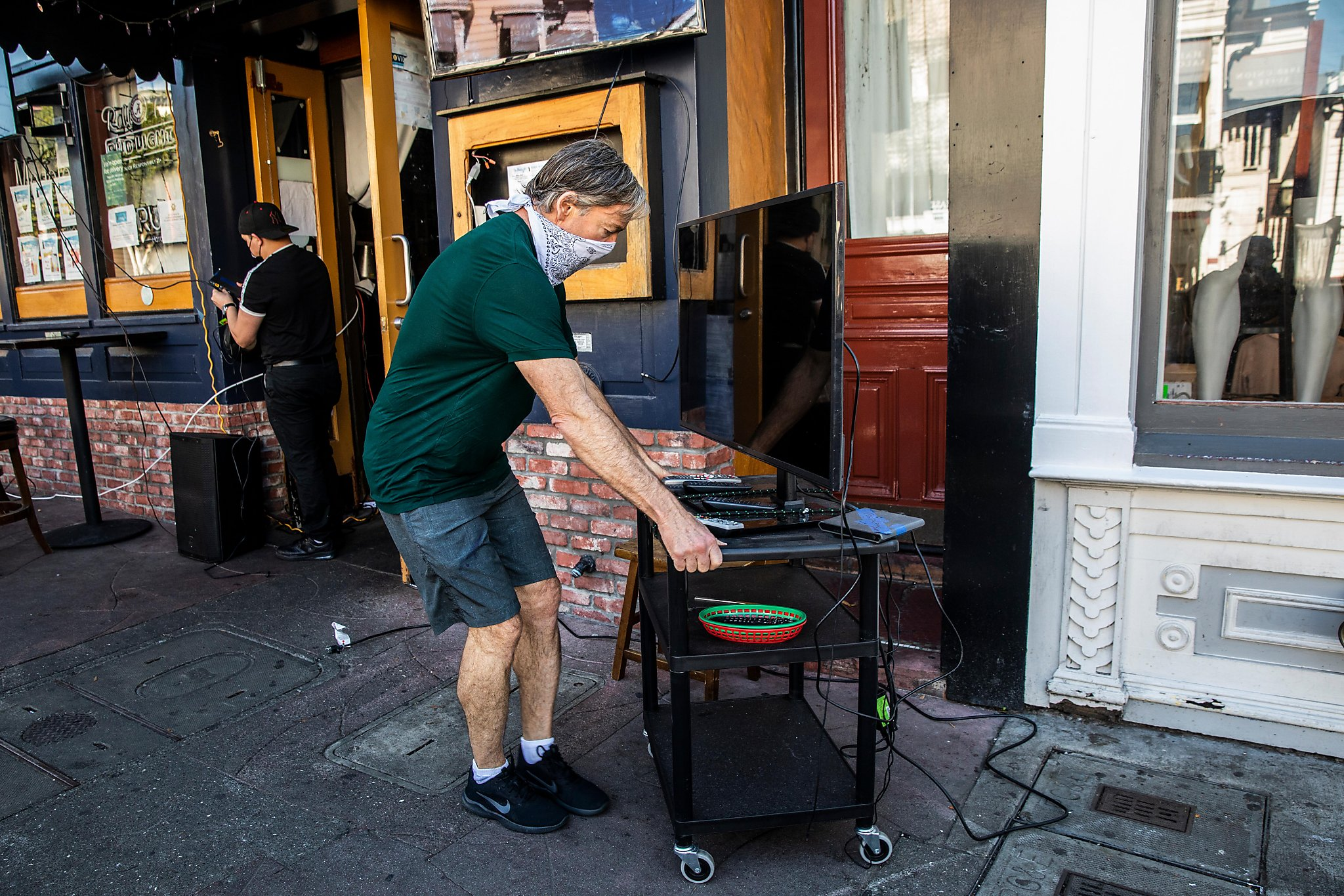 S.F.'s Super Bowl party people do their best to keep spirit going outside in small groups