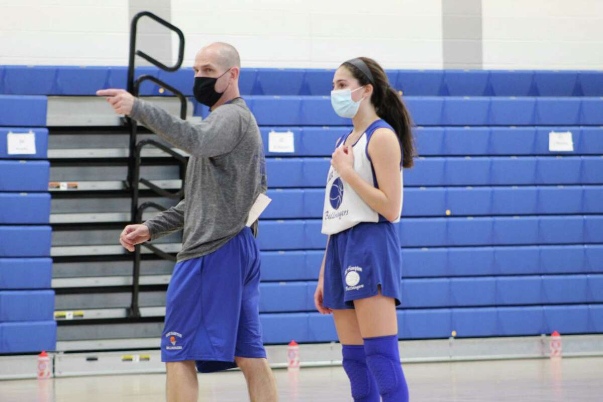 East Hampton coach Shaun Russell, with returning starter Meryl Curtin, and the Bellringers will be defending their Shoreline Conference crown.