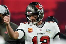Tampa Bay Buccaneers quarterback Tom Brady celebrates after his team scored a touchdown against the Kansas City Chiefs during the first half of the NFL Super Bowl 55 football game Sunday, Feb. 7, 2021, in Tampa, Fla.