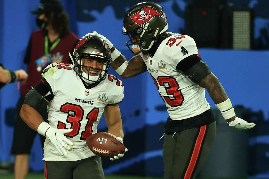 TAMPA, FLORIDA - FEBRUARY 07: Antoine Winfield Jr. #31 and Jordan Whitehead #33 of the Tampa Bay Buccaneers celebrate during the third quarter against the Kansas City Chiefs in Super Bowl LV at Raymond James Stadium on February 07, 2021 in Tampa, Florida. (Photo by Mike Ehrmann/Getty Images) Photo: Mike Ehrmann, Staff / Getty Images / 2021 Getty Images