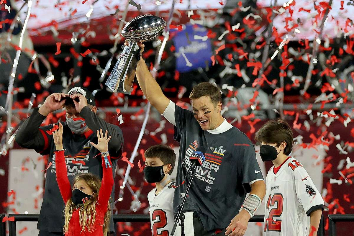 Tom Brady holds the Lombardi Trophy - the seventh he has helped a team win - after Tampa Bay beat Kansas City. He was the Super Bowl MVP for the fifth time.