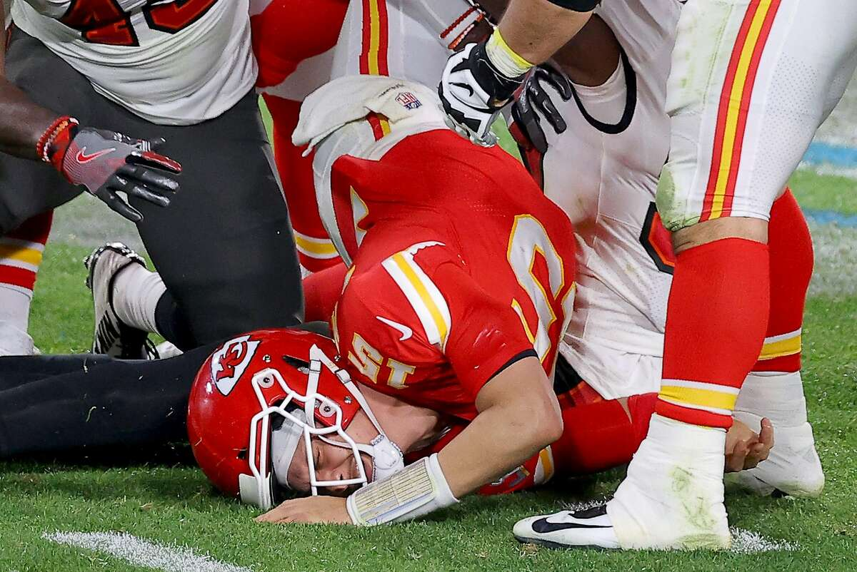 CquPatrick Mahomes #15 of the Kansas City Chiefs is tackled by Devin White #45 and Jason Pierre-Paul #90 of the Tampa Bay Buccaneers in the fourth quarter in Super Bowl LV at Raymond James Stadium on February 07, 2021 in Tampa, Florida. (Photo by Kevin C. Cox/Getty Images)