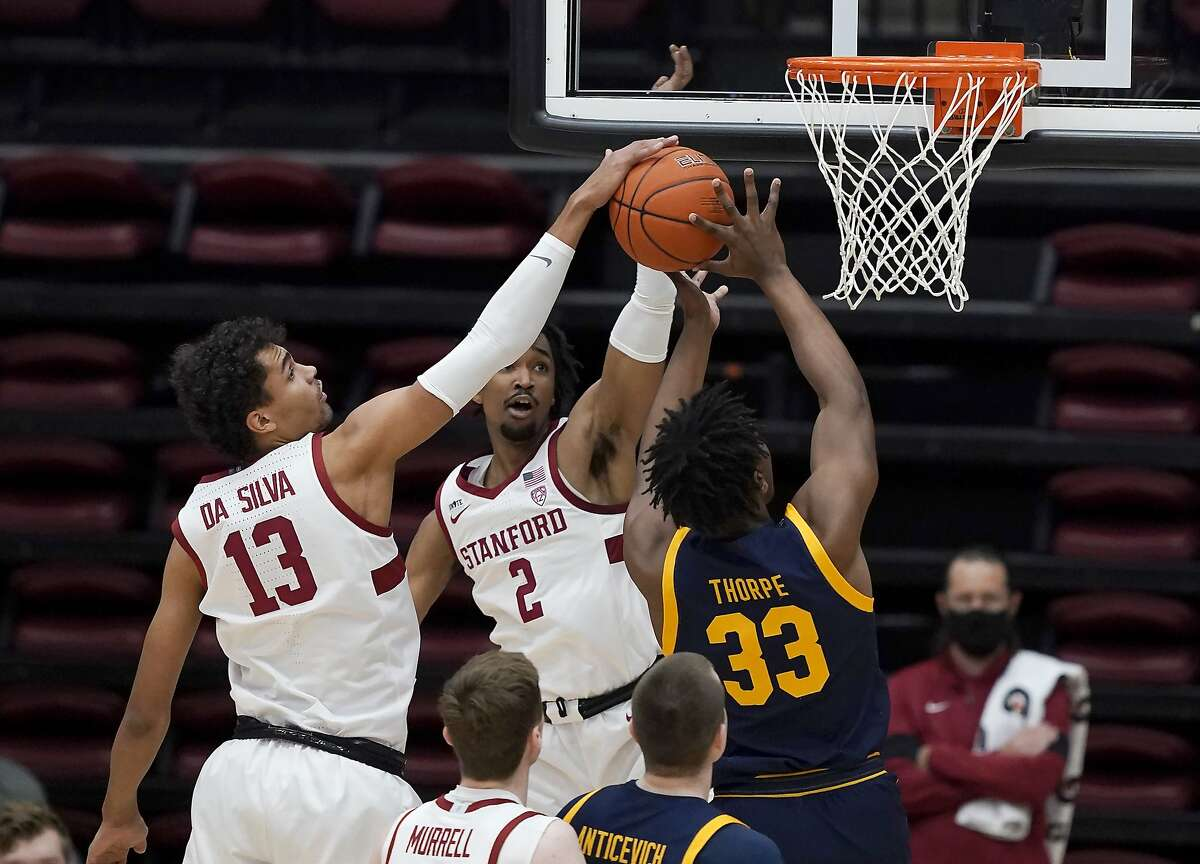 Stanford forward Oscar da Silva rejects the shot by Cal forward D.J. Thorpe. It was one of four blocks by da Silva, who also poured in a game-high 23 points for the Cardinal.