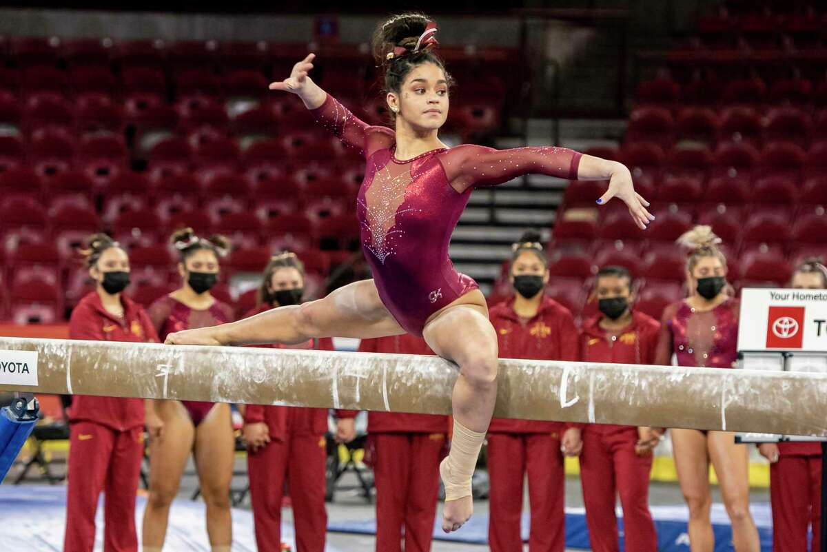 Addy De Jesus competes on the balance beam for Iowa State at Denver. Photo courtesy of Brittany Evans/University of Denver.