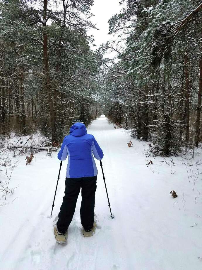 During a recent outdoor adventure at the 40-acre Pine Grove Trail, next to the Morton Township Business Park, Sue Griffith was spotted snowshoeing her way through some fresh snow. (Photo courtesy of Paul Griffith)