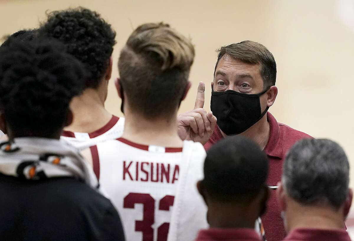 Stanford head coach Jerod Haase talks with his players during a timeout against California in the second half of an NCAA college basketball game in Stanford, Calif., Sunday, Feb. 7, 2021. Stanford won 76-70. (AP Photo/Tony Avelar)
