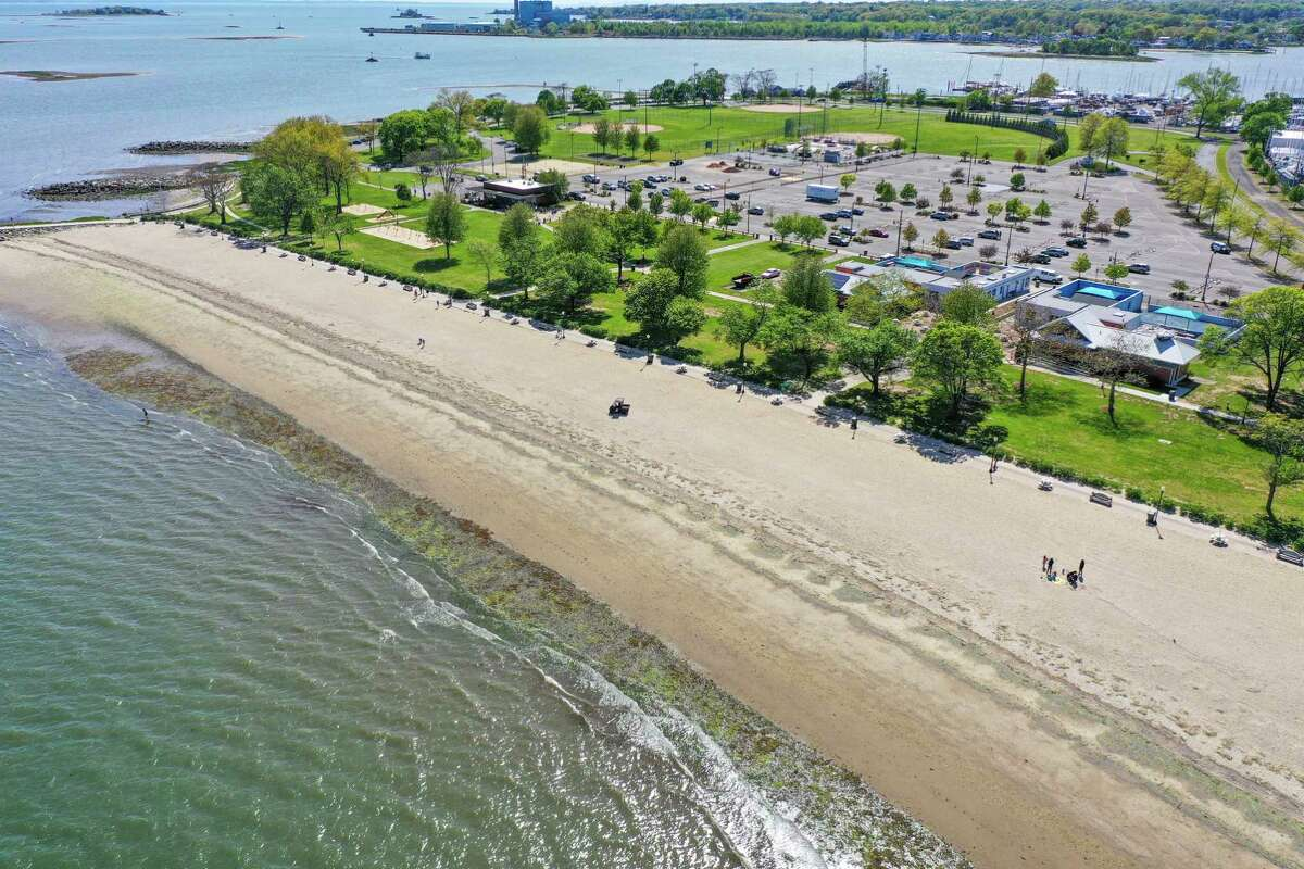 A drone view of Calf Pasture Beach in Norwalk last May. A New Haven lawmaker has introduced a bill that would stop Connecticut municipalities from charging high fees to non-residents to use their beaches.