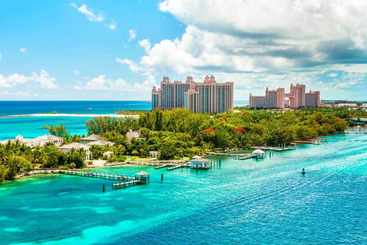 Atlantis Caribbean beach resort at Nassau with white sand coastline and deep blue sea, Bahamas.