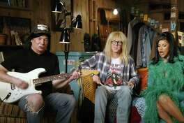 """A still image from an Uber Eats commercial shows, from left, Mike Myers and Dana Carvey reprising their """"Wayne's World"""" characters, along with Cardi B, in an ad scheduled for the Super Bowl broadcast on Sunday, Feb. 7, 2021. (Uber Eats via The New York Times) -- NO SALES; FOR EDITORIAL USE ONLY WITH NYT STORY SLUGGED SUPER BOWL ADS BY TIFFANY HSU FOR FEB. 3, 2021. ALL OTHER USE PROHIBITED. --"""