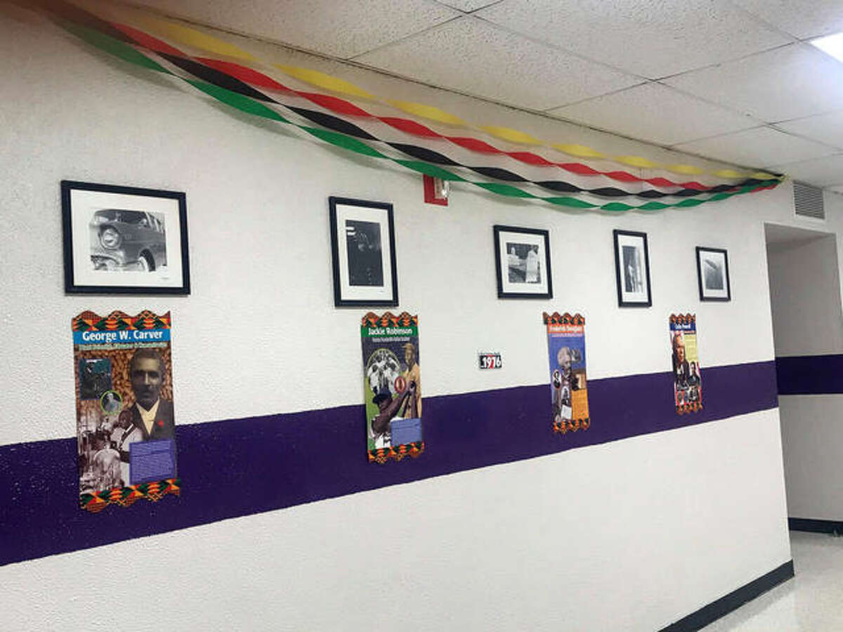 Career synopses dedicated to famous African American people decorate the walls of Collinsville High School. From left are just a few - George Washington Carver, Jackie Robinson, Frederick Douglass and Colin Powell.