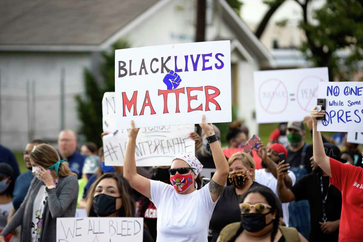 Demonstrators walk through a street in Willis in honor of George Floyd, Wednesday, June 3, 2020. Floyd who died on May 26 has sparked numerous protests throughout the country.