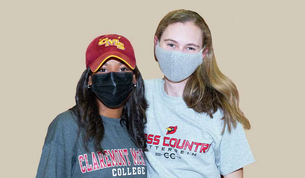 Kinkaid's Ella Brissett (left) celebrates signing her National Letter of Intent to play Claremont McKenna College, and Laura Behr (right) celebrates signing her National Letter of Intent for cross country and track and field at Otterbein University at a ceremony at the school on the evening of Feb. 3