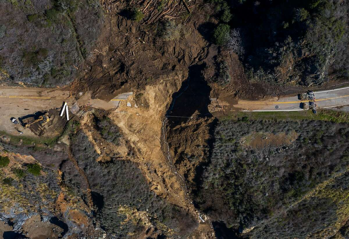Rain storms washed debris the side of a cliff near Rat Creek in Big Sur, causing Highway 1 to collapse on Feb. 4, 2021.