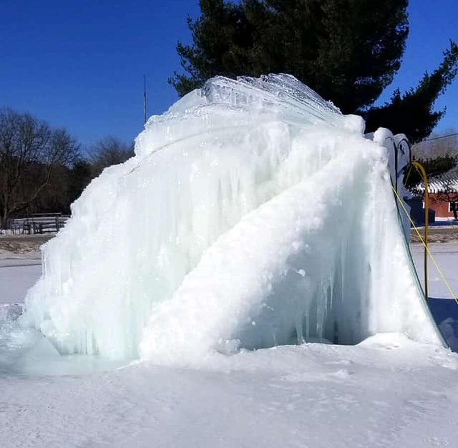 Evart resident Linda Brazelton creates a iceberg in her yard each year with a flowing well. This year, the iceberg has grown to about 10 feet. Photo: Courtesy Photo