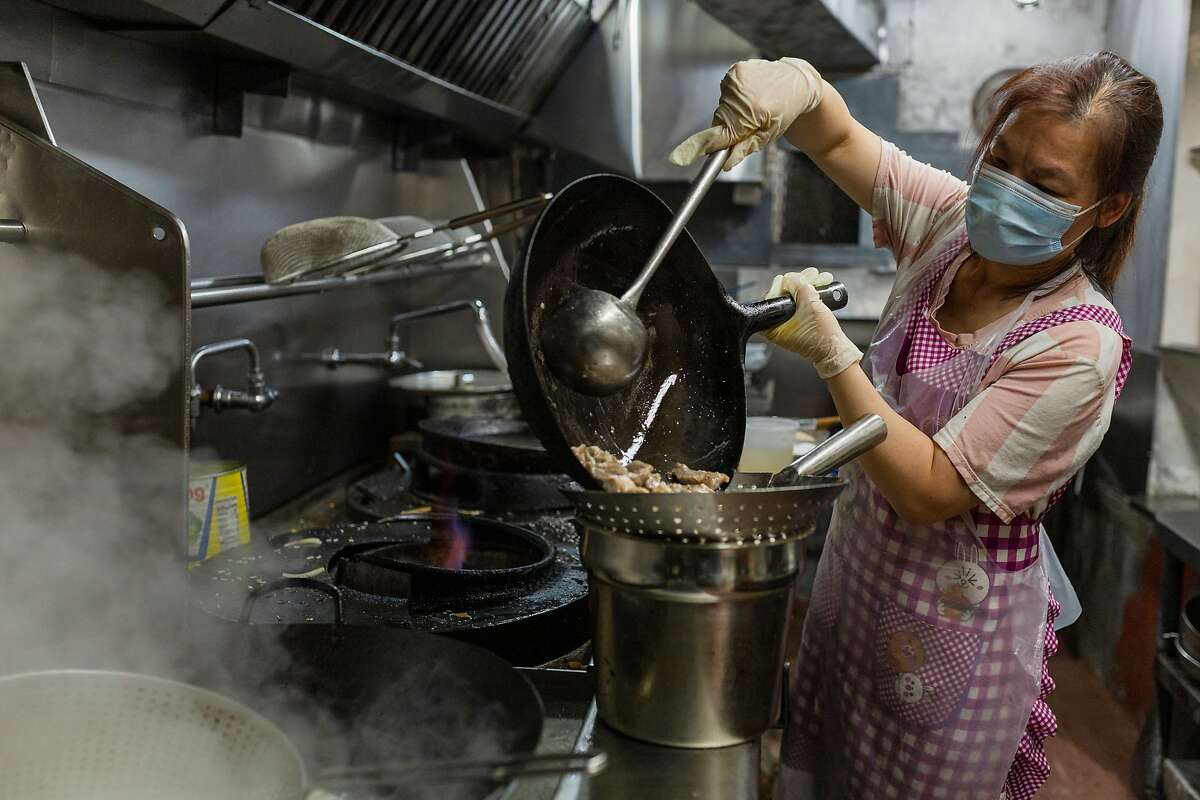 Love Gong, chef at Hang Ah Tea Room in S.F., works in the kitchen of the 100-year-old restaurant.