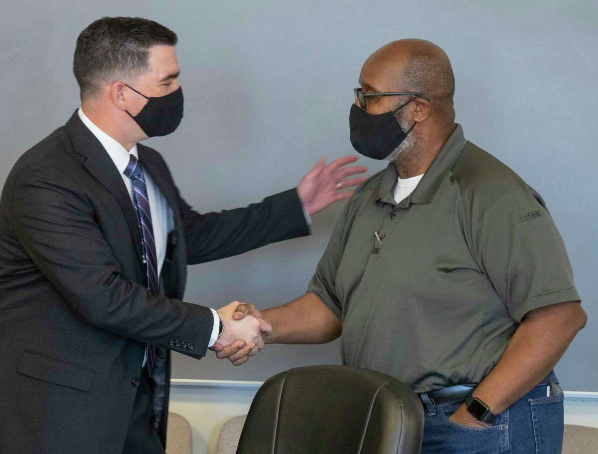 New Midland High football coach Thad Fortune greets MISD board member Tommy Bishop 02/08/2021 at a special board meeting to hire the new coach. Tim Fischer/Reporter-Telegram