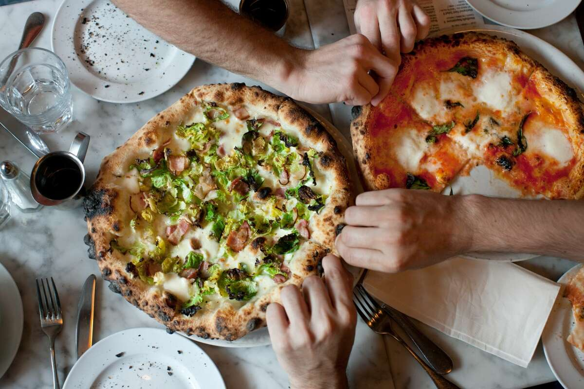 Celebrate National Pizza Day with deals on takeout, delivery