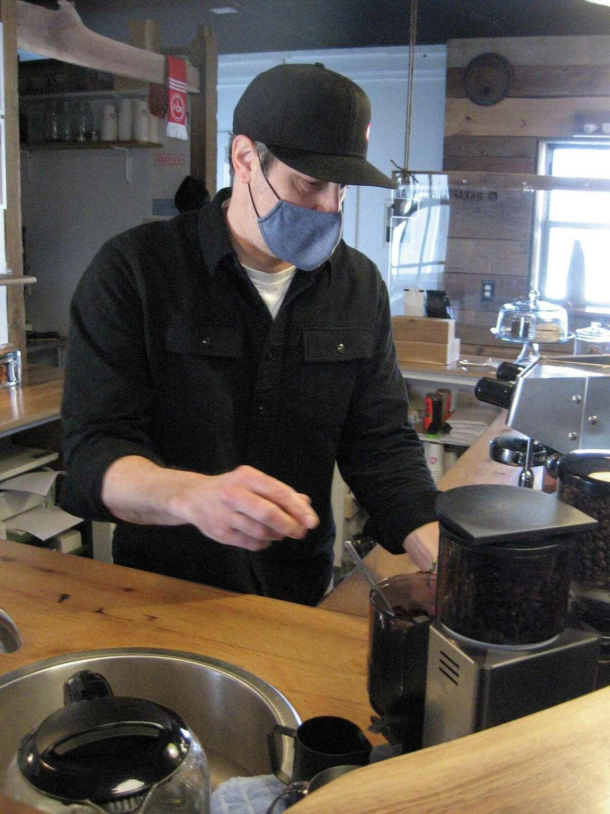 Jason Wallengren brews coffee at Bantam's Krafted Brew Lab.