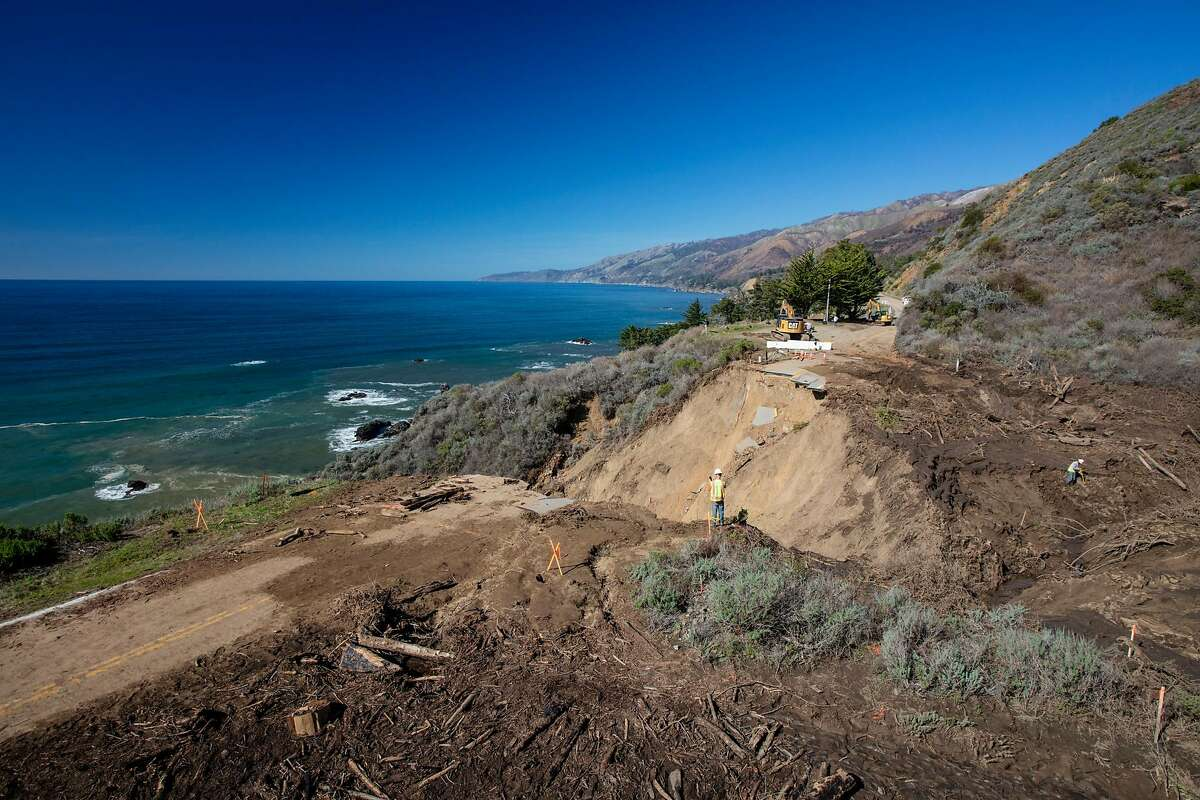 A Caltrans crew works at the site of a washout on Highway 1 near Rat Creek in February.