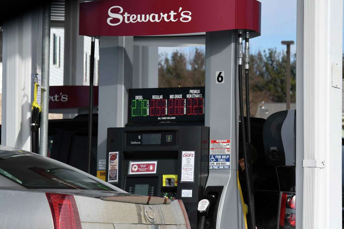 Customers purchase gasoline from the Stewart's Shops store at Albany Shaker and Everett roads on Monday, Feb. 8, 2021, in Colonie, N.Y. Gas prices are spiking thanks to production cutbacks and early signs of economic recovery. (Will Waldron/Times Union)