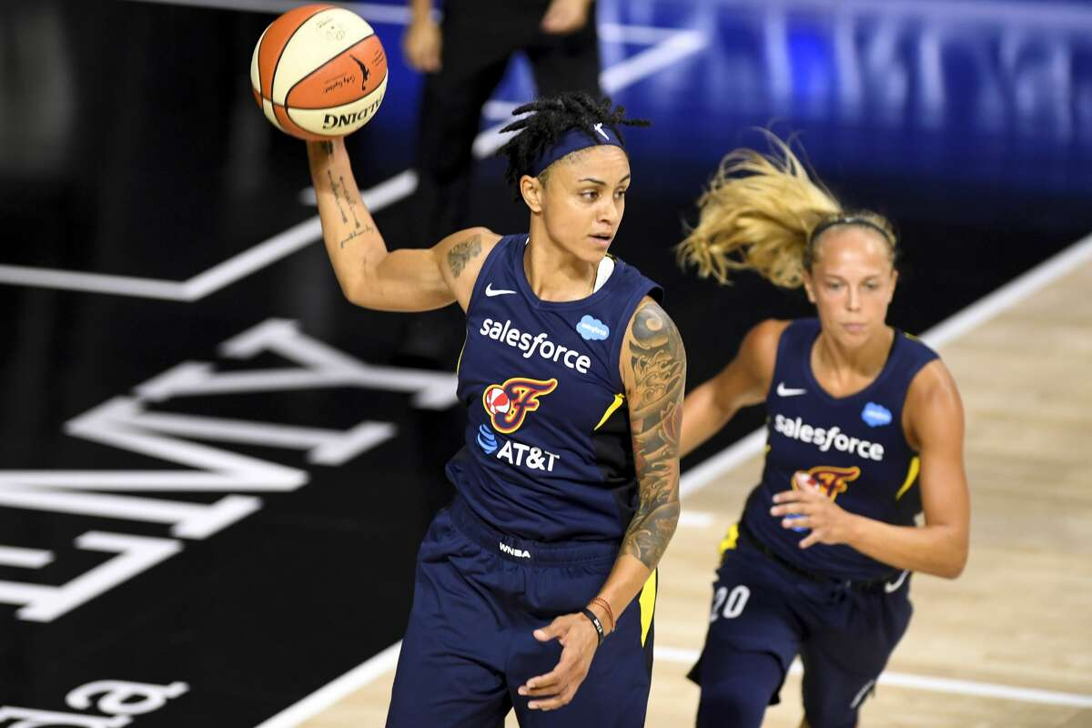 PALMETTO, FLORIDA - AUGUST 22: Candice Dupree #4 of the Indiana Fever handles the ball during the first half against the Chicago Sky at Feld Entertainment Center on August 22, 2020 in Palmetto, Florida. NOTE TO USER: User expressly acknowledges and agrees that, by downloading and or using this photograph, User is consenting to the terms and conditions of the Getty Images License Agreement. (Photo by Douglas P. DeFelice/Getty Images)
