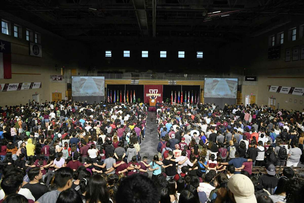 Students and faculty stand on sing the TAMIU Alma Mater during the Freshman Welcome at TAMIU, Friday, September 6, 2019.