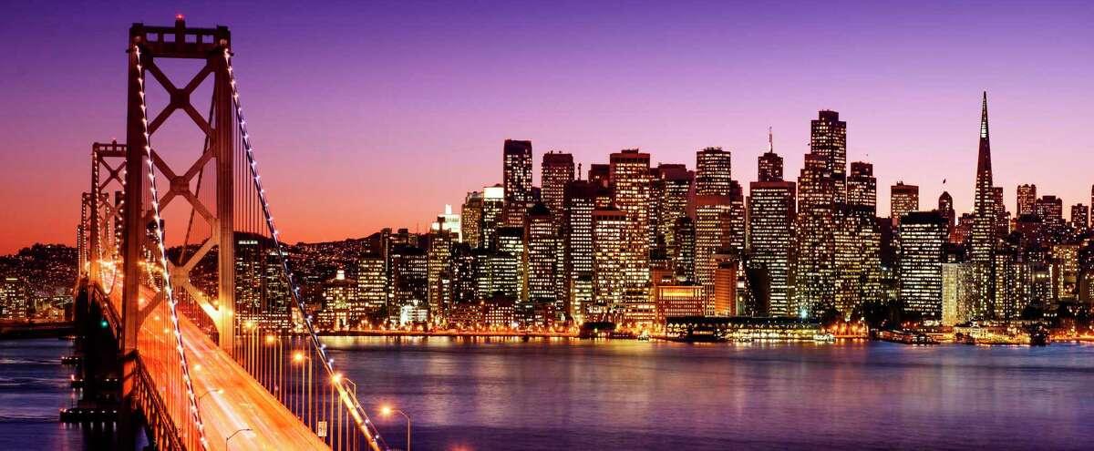 San Francisco skyline and Bay Bridge at sunset.