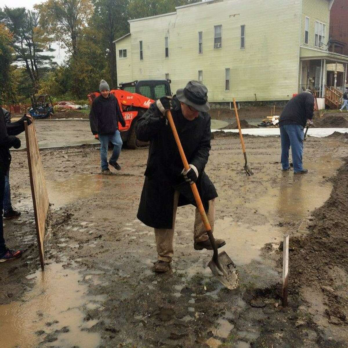 Stanley Hickok, who died Feb. 1, 2021, plants a tree Tribute Park on Eastern Avenue in Schenectady.