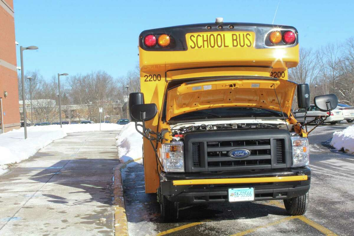 Local officials heralded DATTCO's purchase of a Collins Type A All-Electric School Bus Monday at Middletown High School.