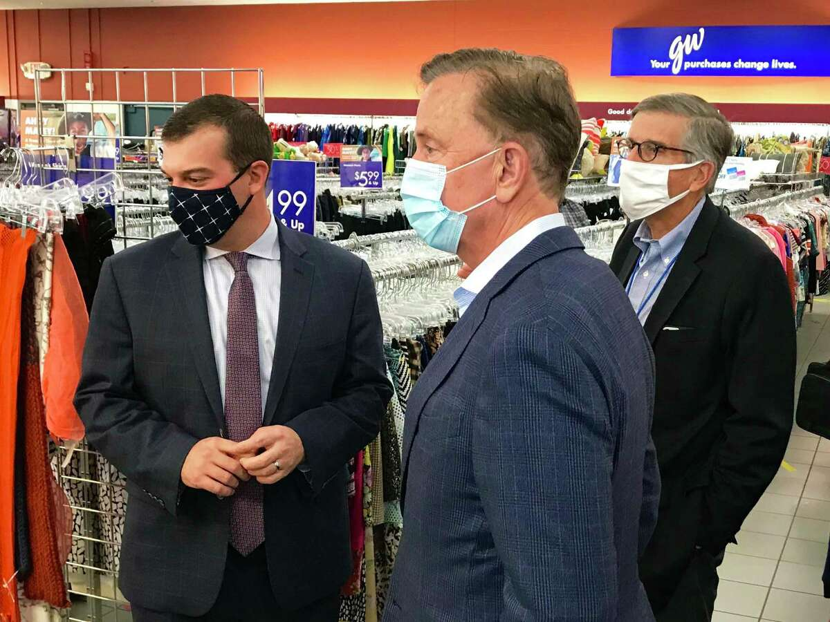 Gov. Ned Lamont, center, in October 2020 alongside Goodwill Industries of Western and Northern Connecticut's interim CEO Jeff Wieser, right, and state Rep. Steve Stafstrom at a Goodwill thrift store in Bridgeport, Conn. (Press photo via Goodwill Industries of Western and Northern Connecticut)