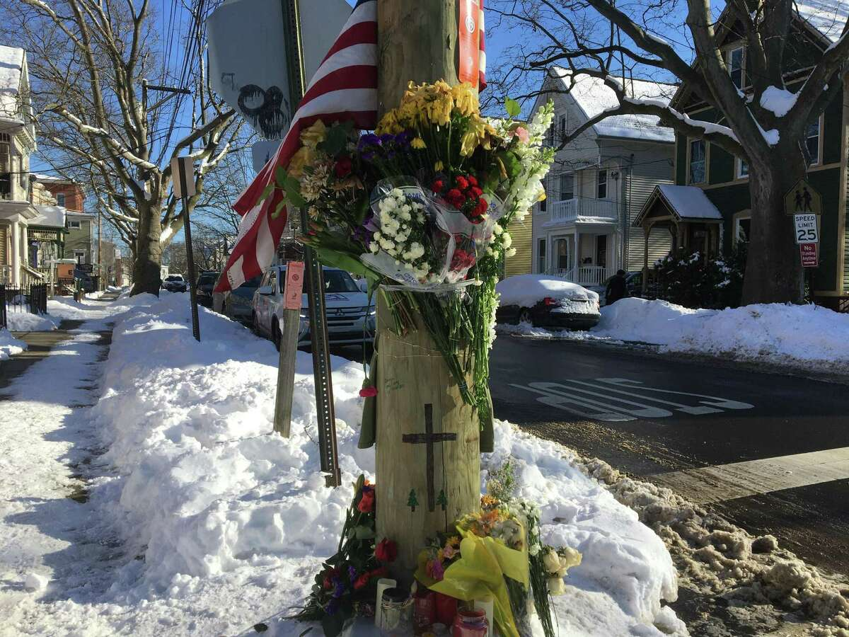 A makeshift memorial, photographed Feb. 8, 2021, on a utility pole at Nicoll and Lawrence streets in the Goatville neighborhood of New Haven's East Rock section, near where Yale University graduate student Kevin Jiang, 26, was shot and killed Feb. 6, 2021.