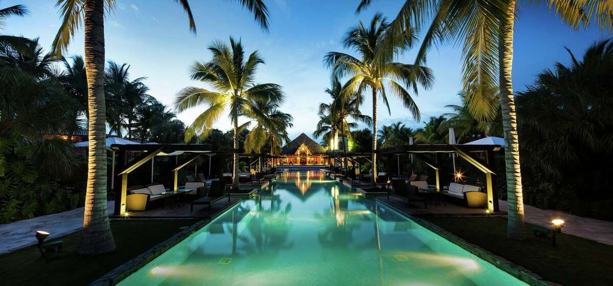 Night view of the pool at The Buenaventura Golf and Beach Resort.