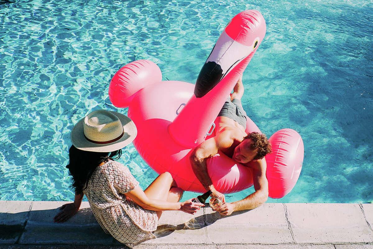 A man and woman enjoying the swimming pool at The Flamingo Resort in Santa Rosa.