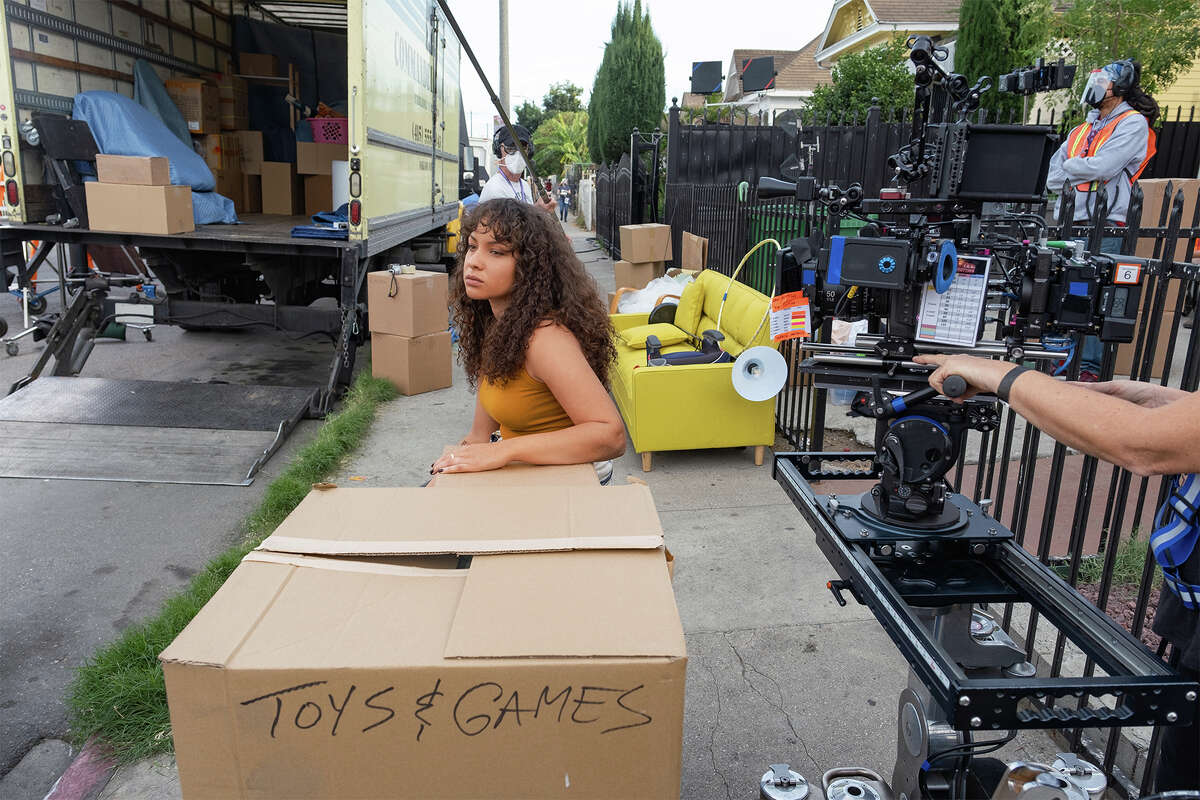 Reprising her role of Ashley Turner, Jasmine Cephas Jones appears between takes for
