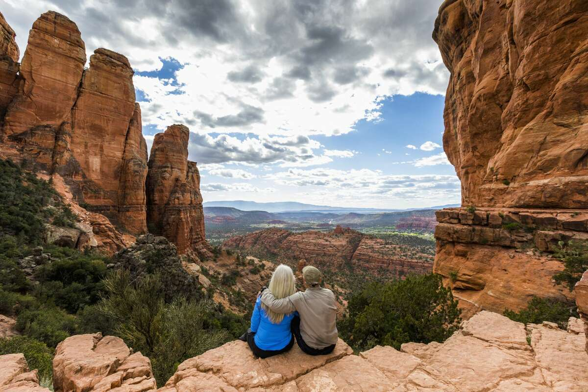 A couple admiring the scenic view in desert landscape.