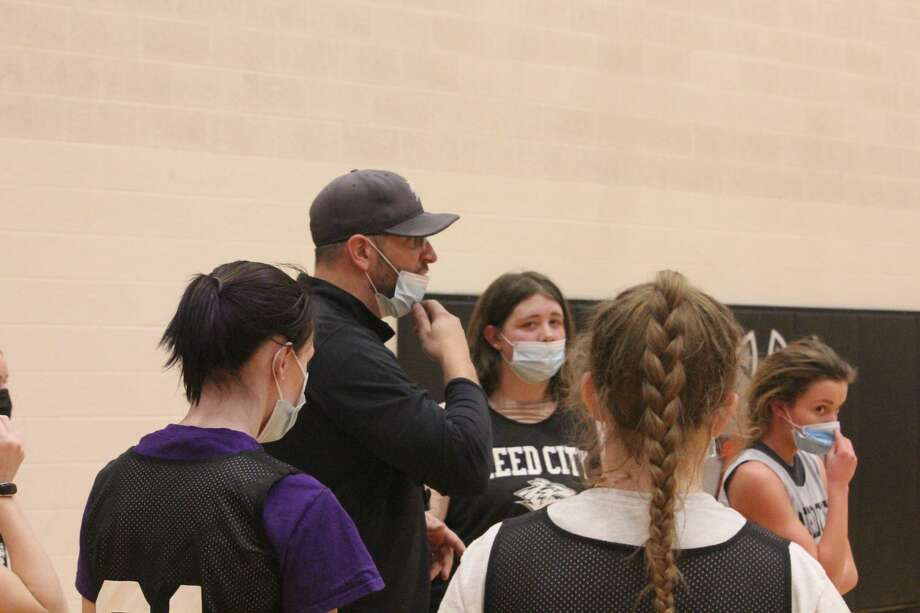 Reed City girls' basketball coach Tim Beilfuss speaks to his players at a recent practice. (Pioneer photo/John Raffel) Photo: Pioneer Photo/John Raffel