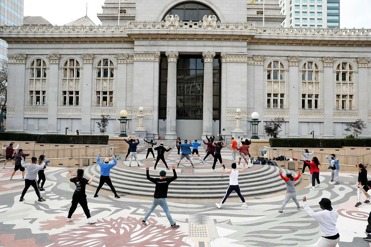 Groove Against the Machine practices in Frank Ogawa Plaza in Oakland.