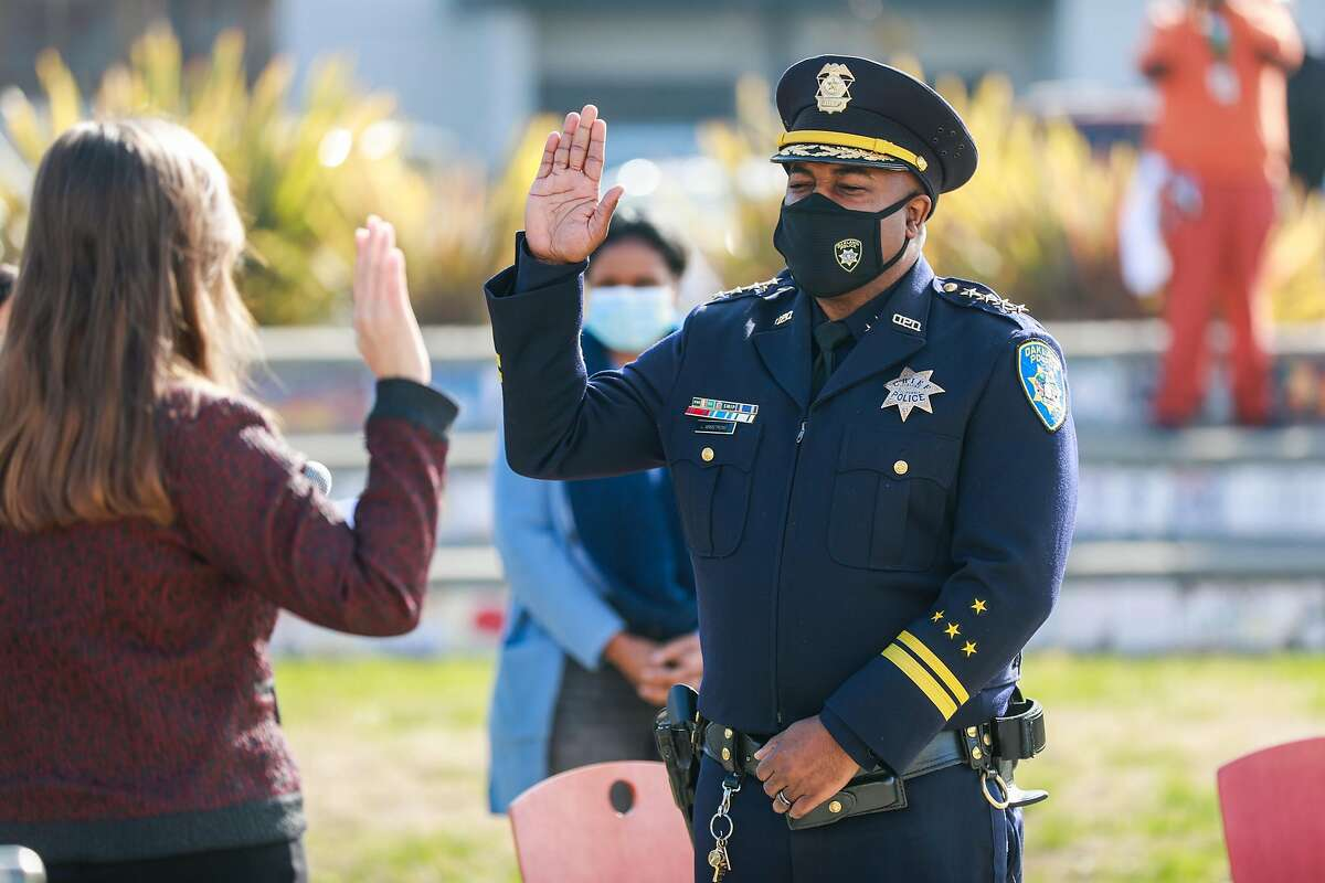 Oakland Mayor Libby Schaaf swears in new Oakland Police Chief LeRonne Armstrong at McClymonds High School on Monday, Feb. 8, 2021 in Oakland, California.