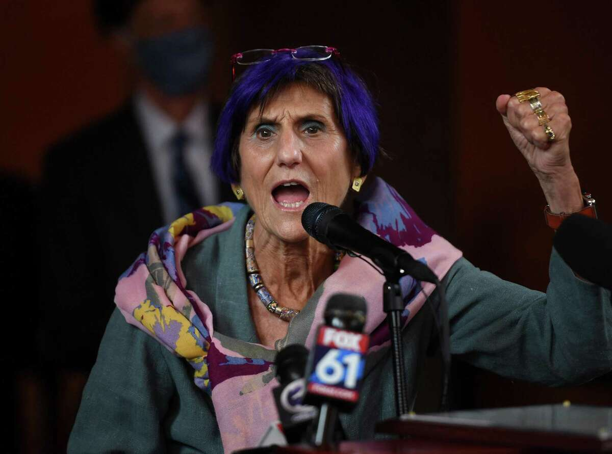 Rep. Rosa DeLauro raises her fist in celebration during the 100th anniversary ceremony at Union Station in New Haven on September 10, 2020.
