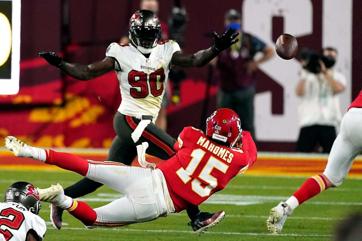 Kansas City Chiefs QB Patrick Mahomes (15) throws a pass while falling against the Tampa Bay Buccaneers during the NFL Super Bowl LV football game on Sunday. Feb. 7, 2021, in Tampa, Fla. (AP Photo/Doug Benc)